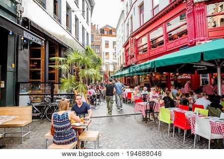ANTWERPEN, BELGIUM - June 02, 2017: Street view with crowded cafes and restaurants at the center of the old town of Antwerpen city in Belgium