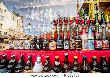 ANTWERPEN, BELGIUM - June 02, 2017: Different belgian beer bottles on the showcase in Antwerpen city