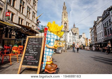 ANTWERPEN, BELGIUM - June 02, 2017: Street view with crowded cafes and fast foods at the center of the old town of Antwerpen city in Belgium