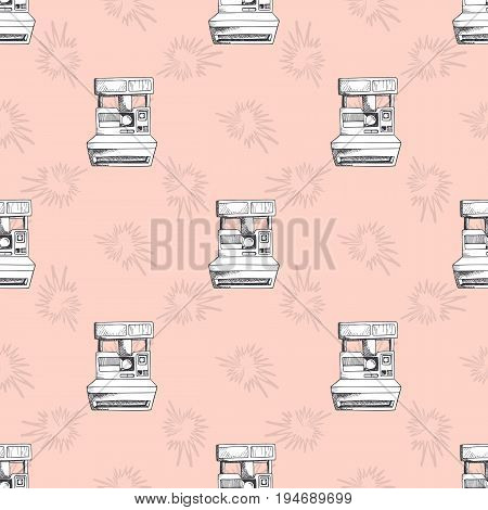 Vector seamless pattern with vintage cameras. Pink background for wrapping textile or fabric.