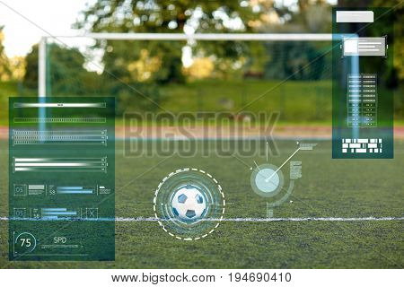 sport, soccer and technology concept - ball and goal on football field