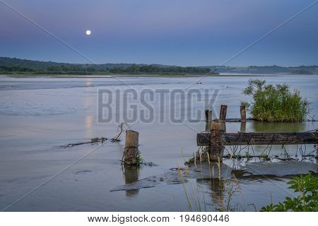 Niobrara National Scenic River in Nebraska Sandhills, summer scenery at dawn with full moon