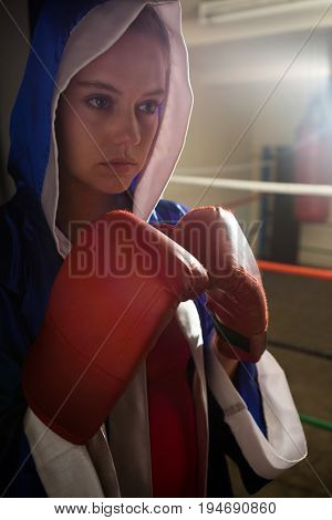 Beautiful woman practicing boxing in fitness studio