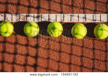 Tennis court line with group of tennis balls