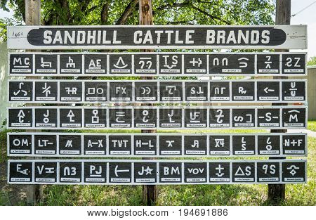 MERRIMAN, NE, USA - July 9, 2017:  Sandhill Cattle Brands 1964, a collection of brands with ranch owners names in a small village of Merriman in Nebraska Sandhills.