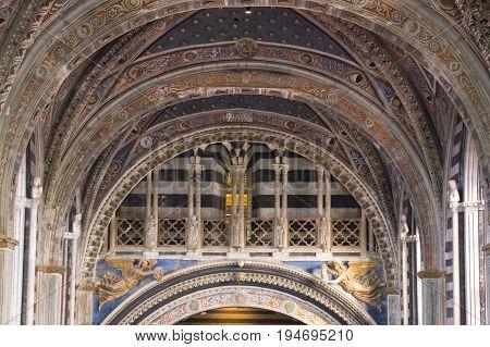 Italy Siena - December 26 2016: close up view of Metropolitan Cathedral of Santa Maria Assunta interior. Nave of Duomo di Siena on December 26 2016 in Siena Tuscany Italy.