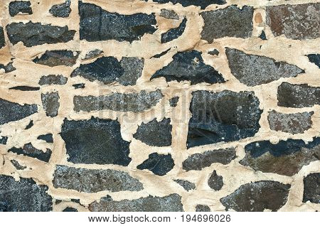 Old Rustic Stonewall Background, black and grey with white mortar