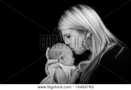 Young mother kissing her newborn baby poster