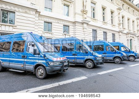 PARIS, FRANCE - JULY 1, 2017: Gendarmerie minibuses of French police parket at Palais de Justice de Paris in Quai des Orfevres road, close to Notre Dame de Paris cathedral.