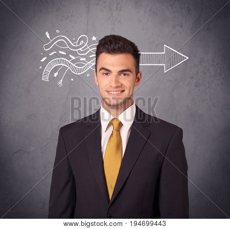 An elegant confident  businessman in suit knows the solution to a problem concept with drawn arrow illustration on urban concrete wall concept