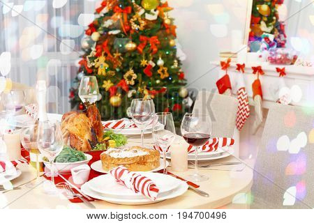 Table served for family Christmas dinner in living room