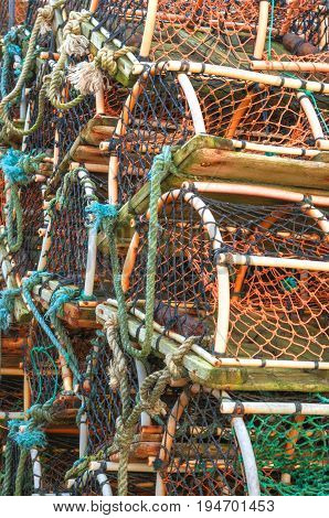 Stack of lobster crab pots traps, ocean themed background