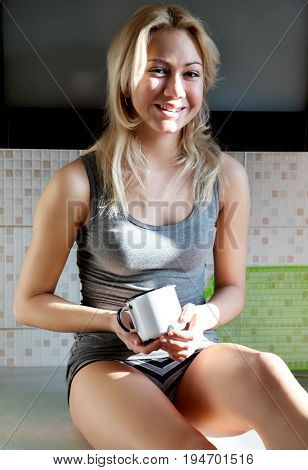 Woman drink coffee or tea in old mug
