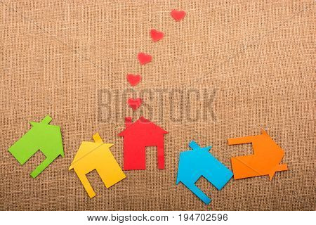 Hearts Coming Out Of Chimney Of Paper House