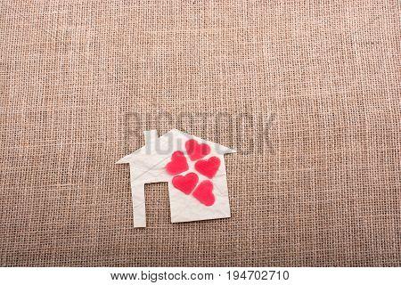 Model House And A Heart Shape Beside