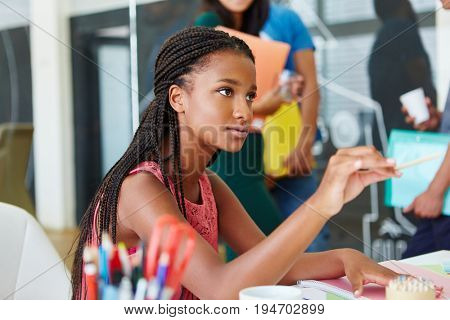 Young african woman as trainee in start-up company