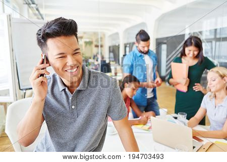 Student in meeting making a call with smartphone