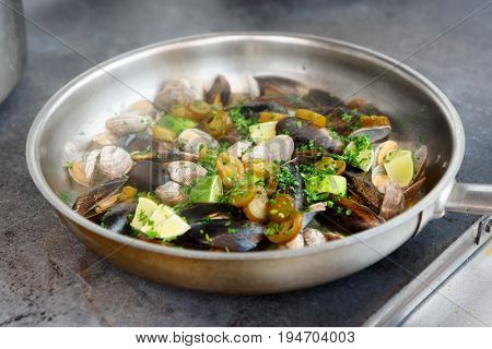 Clams and mussels fried with lime, herbs and jalapeno pepper