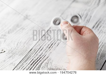 Playing Spinner. A Toy To Relief Stress And Tension.