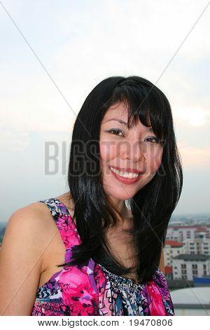 Asian woman outdoors.