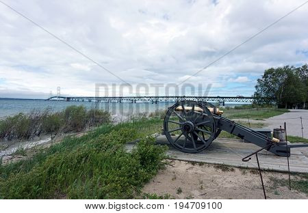 A cannon is aimed at the Straits of Mackinac, near the Mackinac Bridge, at the Colonial Michilimackinac State Park, in Mackinaw City, Michigan.