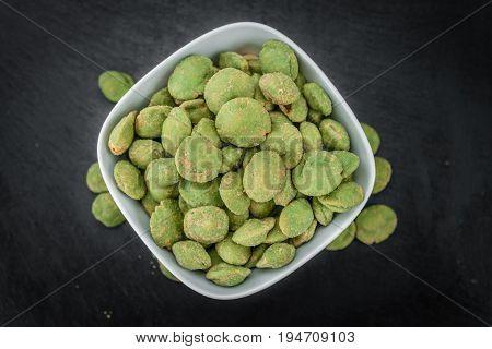 Portion Of Wasabi Coated Peanuts On A Slate Slab