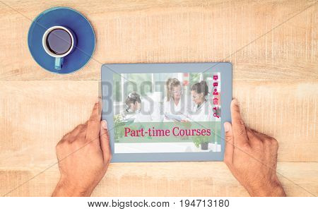 Composite image of part-time courses against hand holding on digital tablet over table by coffee