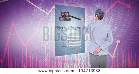 Businesswoman pointing against stocks and shares