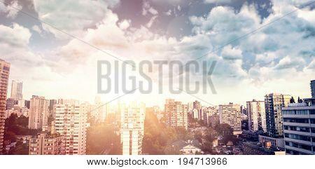 View of overcast against blue sky against city against blue sky