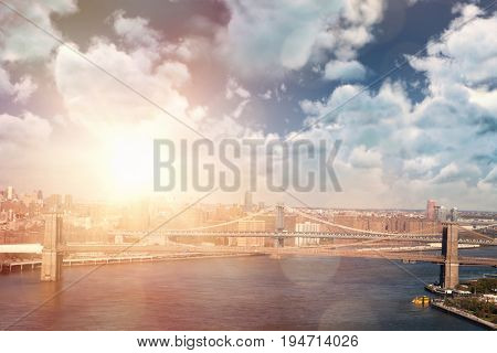 View of overcast against blue sky against high angle view of bridge in city