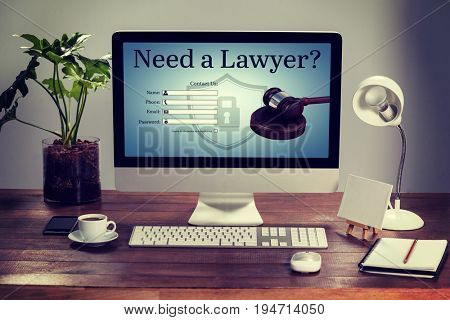Graphic interface of lawyer contact form  against computer with personal organizer and belongings