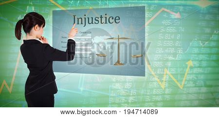 Thoughtful businesswoman pointing against stocks and shares
