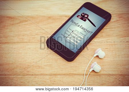 Graphic interface of lawyer contact form  against black smartphone with white headphones