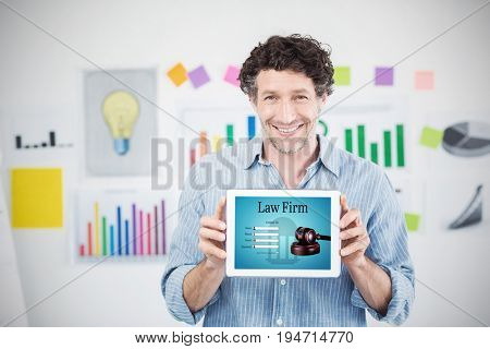 Businessman showing digital tablet with blank screen in creative office against graphic interface of lawyer contact form