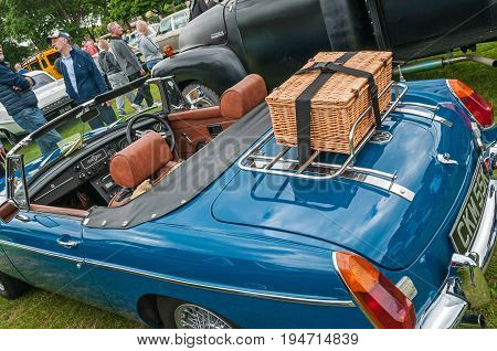 Blue MGB Roadster,Hull, East Yorkshire, England, 11th June 2017, Classic British MG Sports Car, close up showing wicker picnic basket on boot of blue MGB Roadster