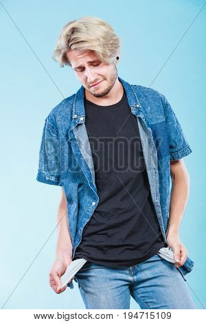 Upset Sad Man Showing Empty Pockets