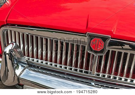 Hull, East Yorkshire, England, 11th June 2017, Classic British MG Sports Car, close up showing grill and badge of red MGB sports car, at East Park Classic Car Run.