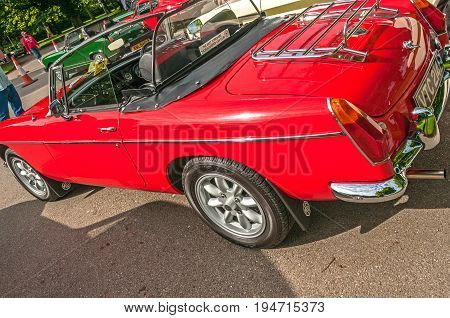 Red MGB Roadster, Hull, East Yorkshire, England, 11th June 2017, Classic British MG Sports Car, side view of red MGB Roadster sports car, at East Park Classic Car Run.