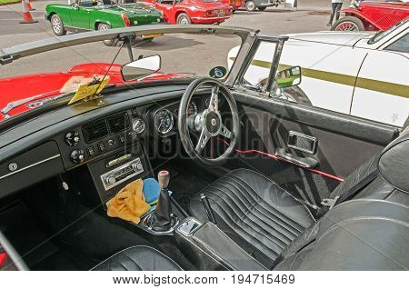 Red MGB Roadster, Hull, East Yorkshire, England, 11th June 2017, Classic British MG Sports Car, close up showing interior and dashboard of red MGB Roadster, at East Park Classic Car Run.
