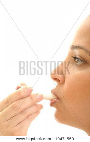 Close up image of a different colored inhaler for asthma in young woman's mouth. White background, vertical, studio picture
