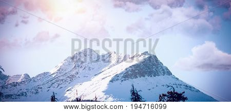 Scenic view of cloudscape  against scenic view of snow covered mountains
