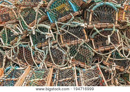 Stack of lobster crab pots traps background