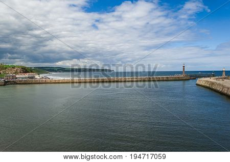 Whitby harbour entrance breakwaters and lighthouses, sea and sky