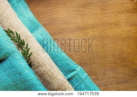 Three-color national flag of Guatemala from rough fabric on a wooden background.