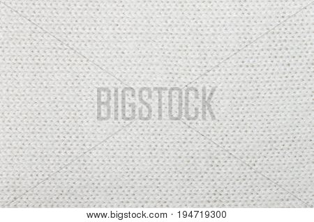 White knitting or knitted fabric texture pattern background. Knitting or knitted. White knitting background. Knitting texture for design.