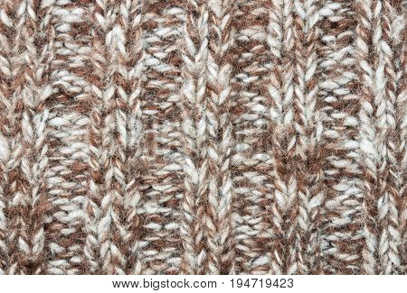 Brown knitting fabric texture background or knitted pattern background. Knitting or knitted background. Brown knitting background. Brown knitting texture.