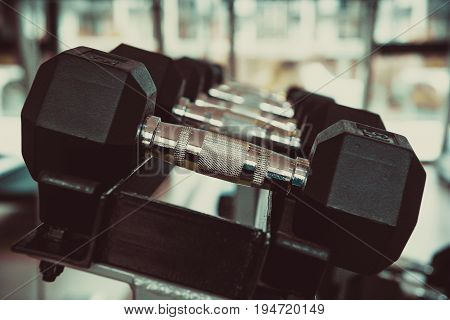 Dumbbells In The Gym At Sports Club For Exercise And Bodybuilding