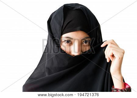 Portrait of young muslim woman with headscarf on a white background.
