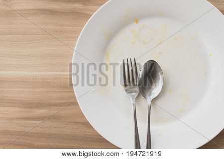 Top view of Empty and dirty dish after eating.