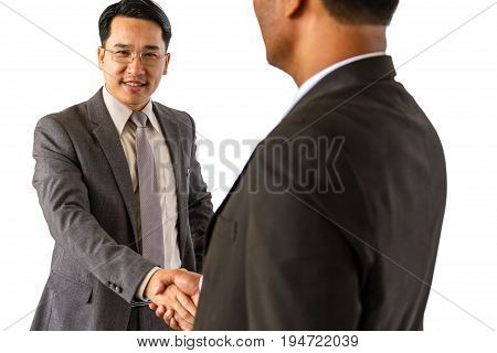 Two happy businessmen shaking hands isolated on white background.